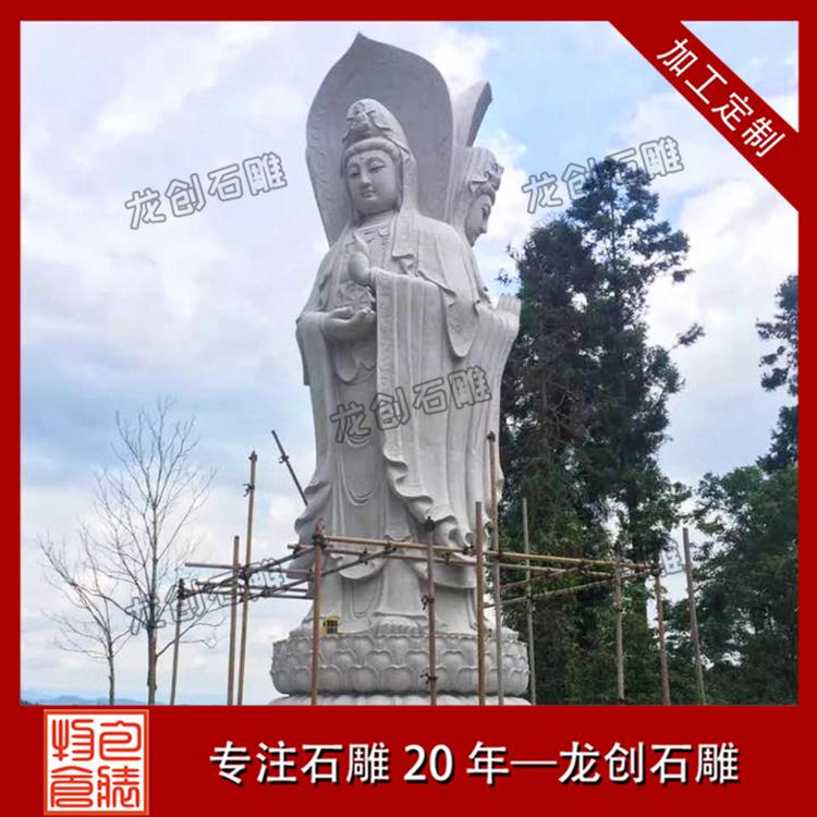 露天三面观音石雕像图片